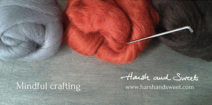 Image of felting wool and needle introducing Harsh and Sweet's blog on mindful crafting